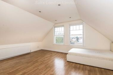 Bright open-plan reception room with ample storage at Balham High Road, Tooting Bec SW17, 7BE